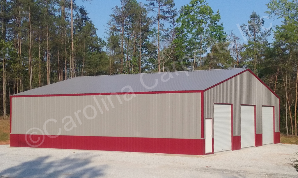 50' wide. All Vertical Fully Enclosed Two Tone Garage with Three 10' x 10' Garage Doors on End
